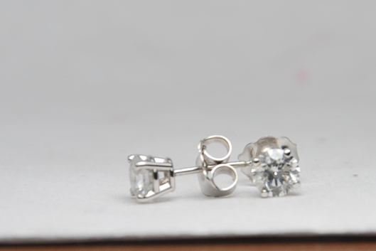 1 carat total weight diamond stud earrings in white gold