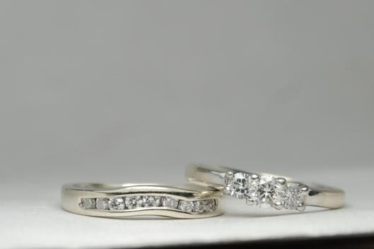 Three stone diamond engagement ring wet
